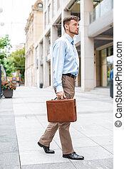 businessman walks with briefcase - handsome Caucasian...