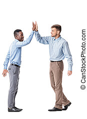 business men giving each other a high five - Young business...
