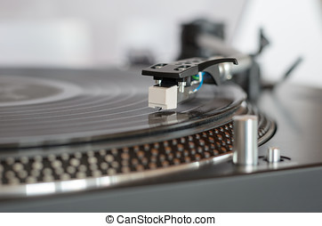 Closeup of a retro turntable while playing a vinyl record