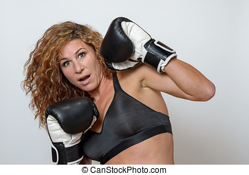 young woman wearing boxing gloves - young woman in...