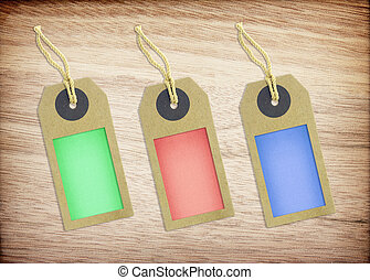 colorful tag paper on wood texture background