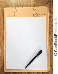 notepaper and pen on wooden background