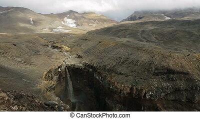 Waterfall in Dangerous Canyon near Mutnovsky volcano in Kamchatka.