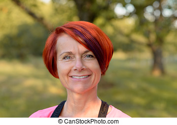 Attractive redhead woman with a friendly smile - Attractive...