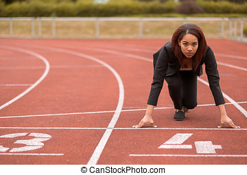 Businesswoman in a Start Position on Race Track - Young...