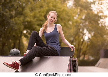 Athletic young woman relaxing outdoor - Athletic casual...