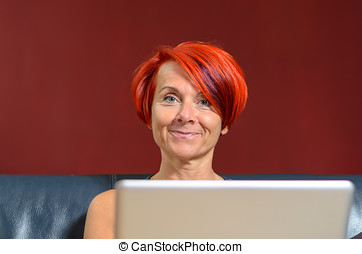 Pretty Adult Woman with Laptop Looking at Camera - Close up...