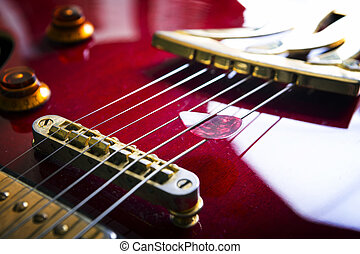 Red acoustic guitar with plectrum. - Red acoustic guitar...