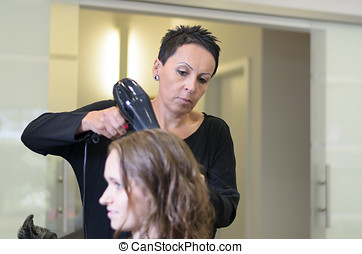 Teen Girl In Salon Drying her Hair with Blow Dryer - Pretty...