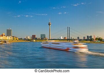 Cityscape of Dusseldorf over the Rhine river in the evening