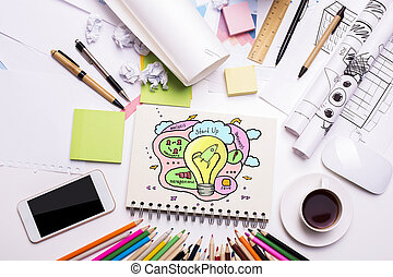 Start up concept - Workplace with creative colorful rocket...