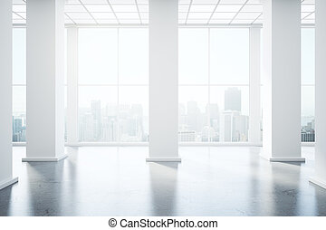 Unfurnished interior with concrete floor, columns and...