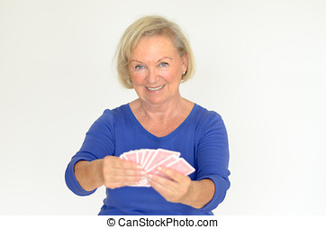 Smiling woman holding a hand of playing cards