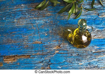 Extra virgin olive oil on blue rustic table