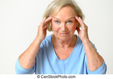Senior woman showing her face, effect of aging - Senior...