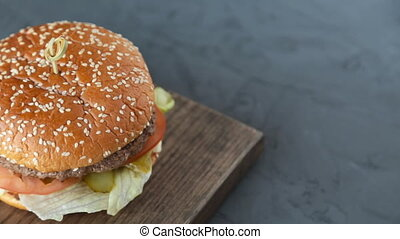 Hamburger on the wooden background