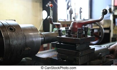 Close up old metal milling machine in workshop