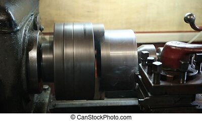 Operator turning part by manual lathe machine. Cutting tool...