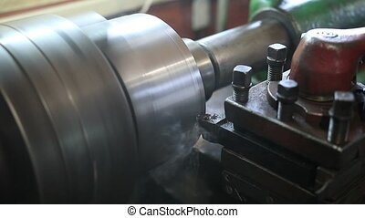 Cutting tool processing on old lathe machine - Close up of...