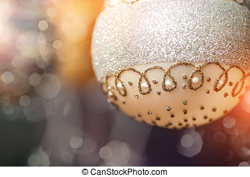 Silver Christmas ball on an abstract background