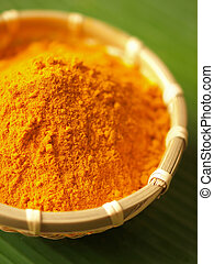 tumeric powder - grounded turmeric in basket