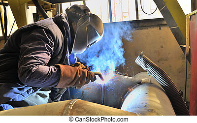 woman welder welding with mig-mag method
