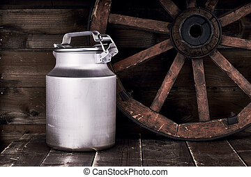 Aluminium water can and old wheel