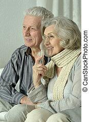 elderly woman with flu inhalation - Portrait of elderly...