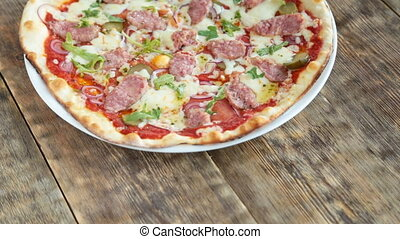Italian pizza served on wooden table - Delicious italian...