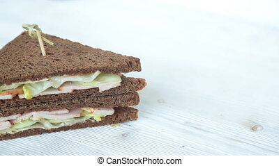 Sandwich on wooden table - Fresh and tasty sandwich on...