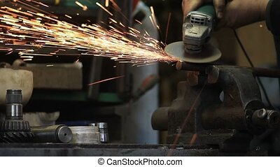 Worker cutting metal with a grinder - Worker cutting metal...