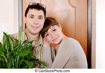 a charming young couple settlers went into their new apartment