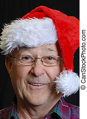happy smiling senior man in santa hat