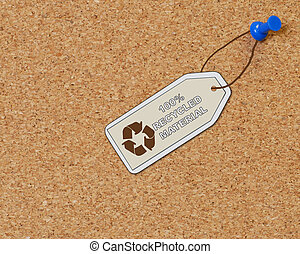 recycled material tag on corkboard