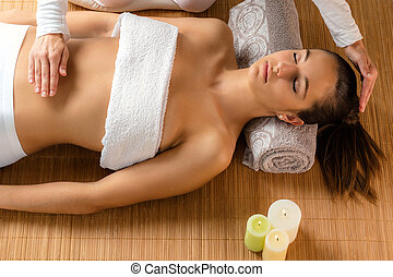 Top view of woman at reiki therapy. - Close up top view...