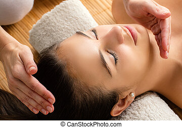 Close up of woman at reiki session - Close up portrait of...