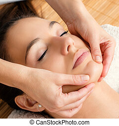 Relaxing facial massage on female chin - Close up portrait...