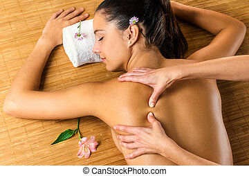 Top view of therapist massaging woman. - Close up top view...
