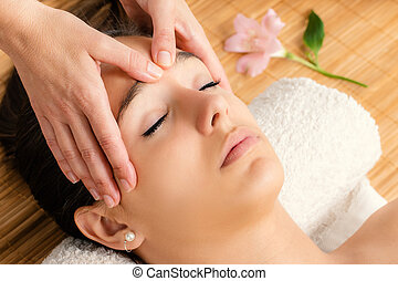 Attractive woman having facial massage. - Close up portrait...