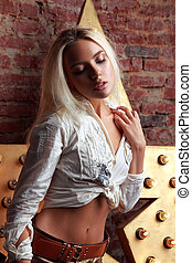 Sexy makeup blond woman posing and touching herself in white...