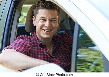 Portrait Of Man Driving Car