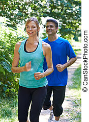 Mature Couple Running In Countryside
