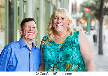 Happy transgender male and female outside - Happy middle...