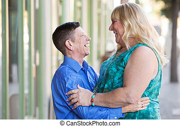 Transgender couple embracing each other - Middle aged adult...