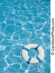 Life preserver - Life ring floating on top of sunny blue...