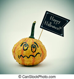 terrified pumpkin and question Happy Halloween? - closeup of...