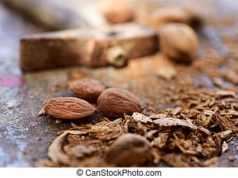cracked almonds and hammer - closeup of a pile of shelled...