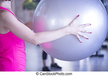 Gym exercise pilates ball in fitness studio.