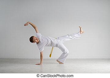 Man practicing Capoeira , brazilian martial Art. - Young Man...