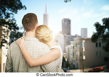 Young couple thinking about vacation on city background